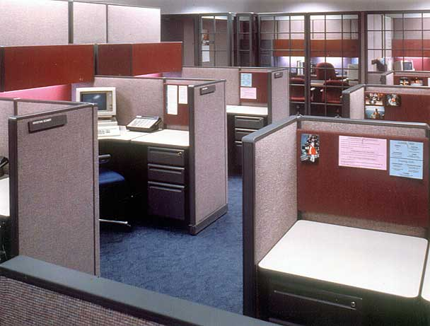 "A ""community"" of workstations. Manager workstations in background have glass fronts."